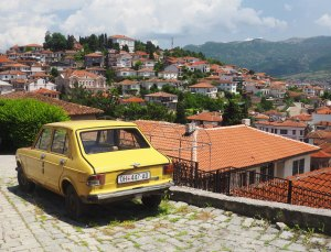 Yellow Zastava and view of Ohrid houses and lake