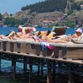 Sunbathers sunbathing on the pier of Lake Ohrid