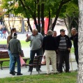 Old men gathered in park in Skopje, Macedonia