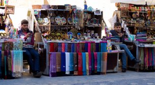 "Bazaar stall with ""attentive"" market sellers"